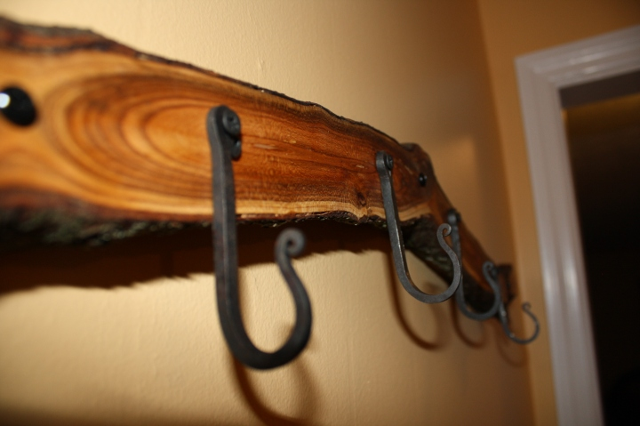 Hand-forged hooks on a plum tree branch